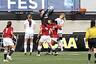 04 December 2011: Stanford's Emily Oliver (19) claims the ball over Duke's Kaitlyn Kerr (5). The Stanford University Cardinal defeated the Duke University Blue Devils 1-0 at KSU Soccer Stadium in Kennesaw, Georgia in the NCAA Division I Women's Soccer College Cup Final.