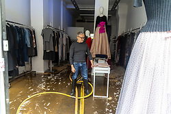 Licensed to London News Pictures. 05/10/2021. London, UK. Jacques Azagury fashion designer to Princess Diana surveys his shop for damage in Knightsbridge, west London where many shops were damaged in severe flooding this morning after torrential rain hit most of London last night. Heavy rainfall has caused severe flooding in London with many roads blocked with flood water and cars trapped. Photo credit: Alex Lentati/LNP