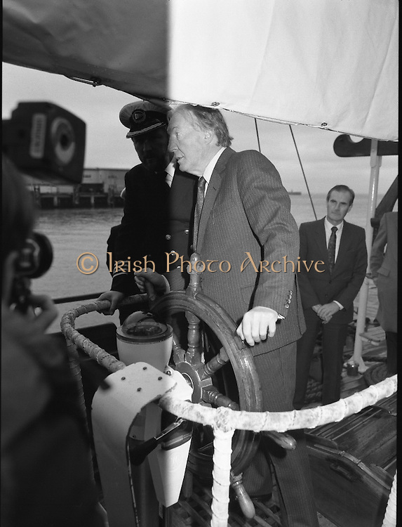 Asgard II departs for Australia.   (R66)..1987..15.10.1987..10.15.1987..15th October 1987..The Asgard II training ship departed from the National Yacht Club in Dun Laoghaire en route to Australia. The Asgard II was a purpose built training brigantine built by Jack Tyrrell in Wicklow. On hand to sent the Asgard Ii on her way was An Taoiseach, Mr Charles Haughey, and Mr Frank Milne the Australian Ambassador to Ireland...A keen yachtsman himself, Mr Haughey, takes the helm of the Asgard II.