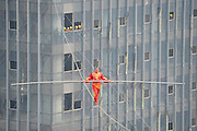 TAIYUAN, CHINA - MARCH 05: (CHINA OUT) <br /> <br /> Saimaiti Aishan walks on a tightrope 190 meters above the ground<br /> <br /> Dawazi performer Saimaiti Aishan walks on a tightrope 190 meters above the ground during a performance at Wanda Center on March 5, 2015 in Taiyuan, Shanxi province of China. Saimaiti Aishan is the seventh generation of Dawazi from northwest China\'s Xinjiang Uygur Autonomous Region and he is skilled in performing stunts including handstands, dances and even balancing a chair on the wire.<br /> ©Exclusivepix Media