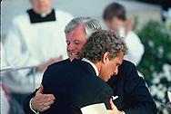 Senator Ted Kennedy and Joe Kennedy hug at a memorial service at Arlington Cemetary for Robert Kenndy<br />Photo by Dennis Brack