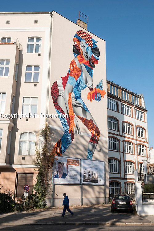 Large mural appointed on side of apartment building in Prenzlauer Berg Berlin Germany