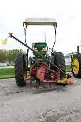 04 May 2013:   Arranged to coincide and be a part of the Red Corridor Route 66 festival, the village of Lexington hosts an antique tractor show.  Roger Whaley is the chairman of the organizing committee.  1957 John Deere model 520 with grass cutter bar attached.