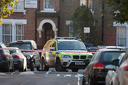 Queens Park, London,October 8th 2015. Police have cordoned off several roads as scene of crime detectives carry out their forensic investigation, following the shooting of a man allegedly armed with a knife, by officers after attempts to taser him failed. The shot man was taken to hospital. PICTURED: One of several police vehicles that appear to have been involved in the incident.  Contact: paul@pauldaveycreative.co.uk Mobile 07966 016 296