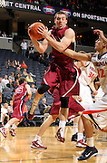 Nov 6, 2010; Charlottesville, VA, USA; Roanoke College g Matt Crizer (25) grabs a rebound Saturday afternoon in exhibition action at John Paul Jones Arena. The Virginia men's basketball team recorded an 82-50 victory over Roanoke College.