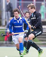 UTRECHT- Hockey -  Willem Rath van HGC tijdens de hoofdklasse competitiewedstrijd tussen de mannen van Kampong en HGC (2-1). links Sjoerd de Wert van Kampong. COPYRIGHT KOEN SUYK