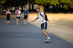 © Licensed to London News Pictures. 24/07/2018. London, UK. A skateboarder in Greenwich park, as the sun sets over London after temperatures in the South East of England reached over 30 degrees celsius today. Temperatures are set to rise up to 35 degrees on Thursday, as the UK experiences a prolonged heatwave. Photo credit : Tom Nicholson/LNP