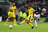 Kwesi Appiah (9) of AFC Wimbledon passes the ball during the EFL Sky Bet League 1 match between Plymouth Argyle and AFC Wimbledon at Home Park, Plymouth, England on 6 October 2018.