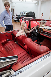 © Licensed to London News Pictures. 12/08/2016. London, UK. Sotheby's employees are seen with James Mason's Mercedes-Benz 300 SE Cabriolet, purchased from new by the great British actor (est. GBP 150,000 - 250,000), at the photocall for classic cars at Sotheby's, New Bond Street, ahead of their auction on 7 September in Battersea Park. Photo credit : Stephen Chung/LNP