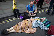 An environmental activist from Extinction Rebellion uses a lock-on to block a road in the Covent Garden area during the first day of Impossible Rebellion protests on 23rd August 2021 in London, United Kingdom. Extinction Rebellion are calling on the UK government to cease all new fossil fuel investment with immediate effect.