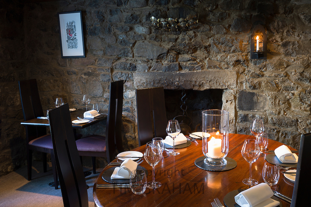 Table place setting with glassware, crockery, cutlery and napkins at world renowned gastronomic five star restaurant The Three Chimneys, Isle of Skye in Scotland