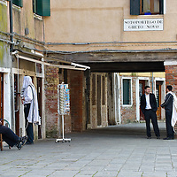 "VENICE, ITALY - NOVEMBER 15: Members of the Jewish community are seen in the main ""campo"" (square) of the Ghetto on November 15, 2011 in Venice, Italy. Established in 1516 the Ghetto of Venice was the area were Jews were compelled to live during the Venetian Republic. The English term 'ghetto' is derived from the Venetian term for 'slag' and refers to the refuse left the foundry that was located on the same island. In present times the ghetto is a multi-ethnical area area seen as the cultural heart of the city, but with five synagogues remains the centre of the of Jewish community."