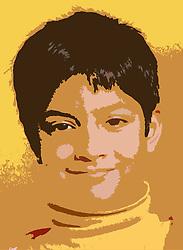Studio portrait of young boy smiling,