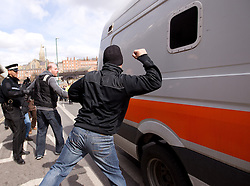 © Licensed to London News Pictures. 04/04/2013.Nottingham, UK. Nottingham residents who are sickened by the events in Derby bang and shout abuse as the vans leave to take the three guilt to start their sentences. The last day of the Philpott fire hearing. Three individuals, Mairead Philpott, Michael Philpott and Paul Mosley are sentenced for manslaughter of 6 children in Derby 2012 at Nottingham Crown Court. sentencing was postponed until 10:30am today (Thursday 4th April 2013)   .   Photo credit : Tom Maddick/LNP