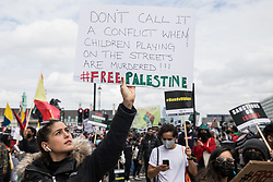 Activists from an International Bloc highlighting current human rights abuses in Palestine, Israel, Colombia and Tigray join tens of thousands of people on the National Demonstration for Palestine on 22nd May 2021 in London, United Kingdom. The demonstration was organised by pro-Palestinian solidarity groups in protest against Israel's recent attacks on Gaza, its incursions at the Al-Aqsa mosque and its attempts to forcibly displace Palestinian families from the Sheikh Jarrah neighbourhood of East Jerusalem.