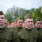 Ukrainian soldiers attend a ceremony that marks 69 years since the Soviets defeated the Nazis, at the War Memorial in central Donetsk, amid tensions over the referendum for autonomy of the region to be held over the weekend.