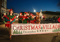 The Elves from Christmas Village march down Main Street during the annual Holiday Parade on Sunday evening.  (Karen Bobotas/for the Laconia Daily Sun)