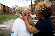"Genice Gipson comforts her ""lifelong friend,"" Loretta Capistran, outside of Capistran's apartment complex in Refugio, Texas, on Monday, August 28, 2017. Capistran hunkered down in her apartment's closet as Hurricane Harvey's 140-MPH winds tore through the Texas coast and anything that sat in its path. ""We got to be strong, baby,"" Gipson told Capistran. NICK WAGNER / AMERICAN-STATESMAN"