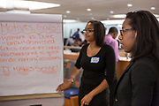 Purchase, NY – 31 October 2014. Saunders Trades and Technical High School student Chyna Artist is at the presentation easel as Morgan Stanley facilitator Breeana Jones looks on. The Business Skills Olympics was founded by the African American Men of Westchester, is sponsored and facilitated by Morgan Stanley, and is open to high school teams in Westchester County.