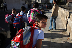 Mohammed Haitham Obeidi, 7, heads to his first day of school in Amman, Jordan, Aug. 20, 2007. His family fled Iraq after threats were made on his father's life. They are now awaiting asylum.