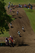 Pauls Jonass leads Jorge Prado and the rest of the MX2 pack after the start of the second moto.