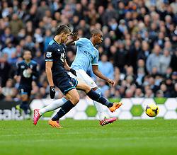Tottenham Hotspur's Erik Lamela kicks the ball away from Manchester City's Fernandinho - Photo mandatory by-line: Dougie Allward/JMP - Tel: Mobile: 07966 386802 24/11/2013 - SPORT - Football - Manchester - Etihad Stadium - Manchester City v Tottenham Hotspur - Barclays Premier League