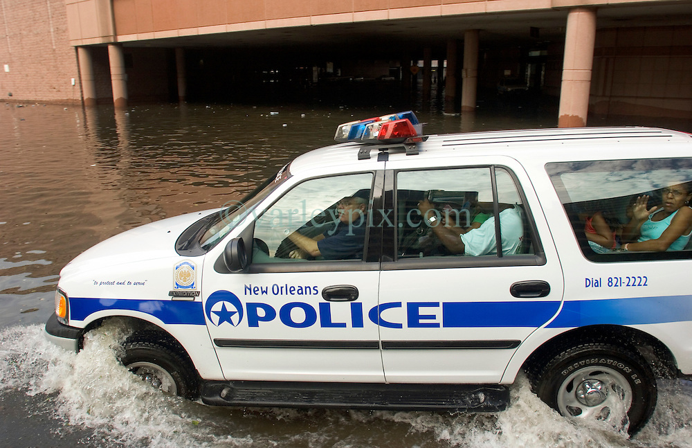 30 August 2005. New Orleans, Louisiana. <br /> Hurricane Katrina aftermath.  <br /> NOPD evacuate friends and relatives from the Hyatt Hotel as the flood waters continue to rise.<br /> Photo Credit: Charlie Varley/varleypix.com