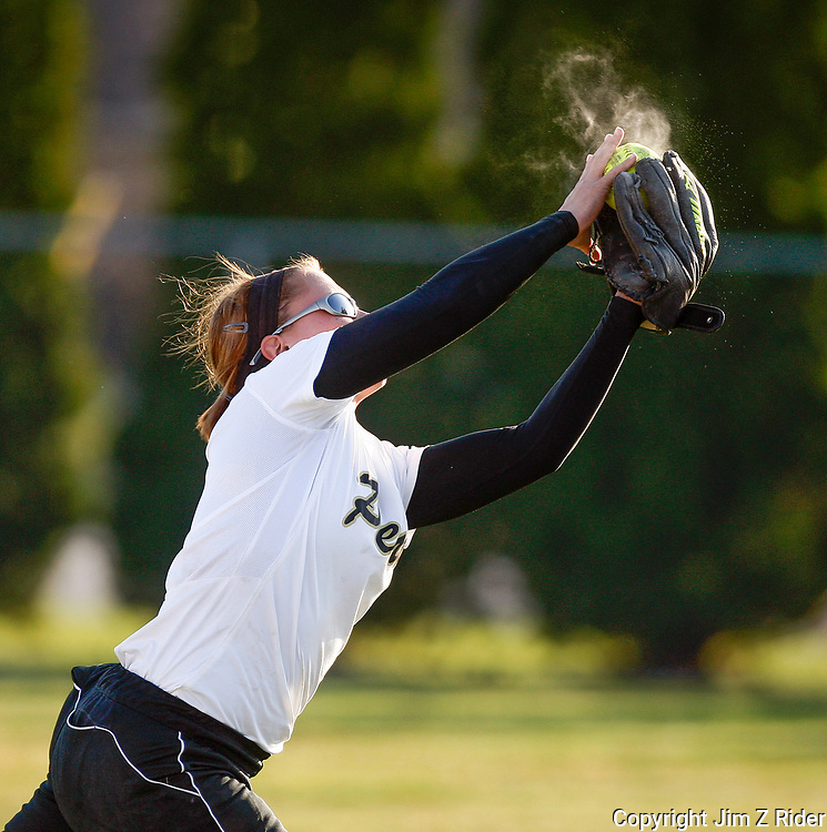 With the sun setting, Penn High School's (Mishawaka, IN) Megan Miller makes a running catch against Lake Central at Penn.