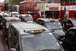 © Licensed to London News Pictures.  27/07/2012. LONDON, UK. Taxi drivers cause gridlock around Hyde Park Corner during the latest protest about their exclusion from the lanes reserved for Olympic vehicles. The Metropolitan Police had imposed conditions on the protest but the taxi drivers simply brought it forward. Photo credit :  Cliff Hide/LNP