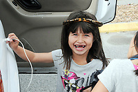 "Jenifer Garcia, 5, has fun ""plugging in"" the car in the warming shelter parking lot in Salinas."