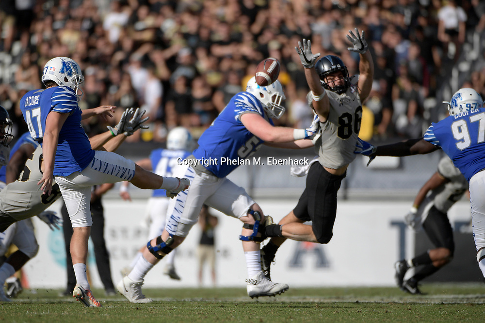 Memphis punter Nick Jacobs (47) kicks the ball in front of Central Florida tight end Michael Colubiale (86) during the second half of the American Athletic Conference championship NCAA college football game Saturday, Dec. 2, 2017, in Orlando, Fla. Central Florida won 62-55. (Photo by Phelan M. Ebenhack)