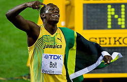 Jamaica's Usain Bolt celebrates winning the men's 100m final race of the 2009 IAAF Athletics World Championships ahead of US Tyson Gay (L) on August 16, 2009 in Berlin. Jamaican Usain Bolt set a new world record of 9.58 seconds in winning the final of the men's 100m at the World Athletics Championships. His time bettered his own world record of 9.69sec set in the Beijing Olympics final. (Photo by Vid Ponikvar / Sportida)
