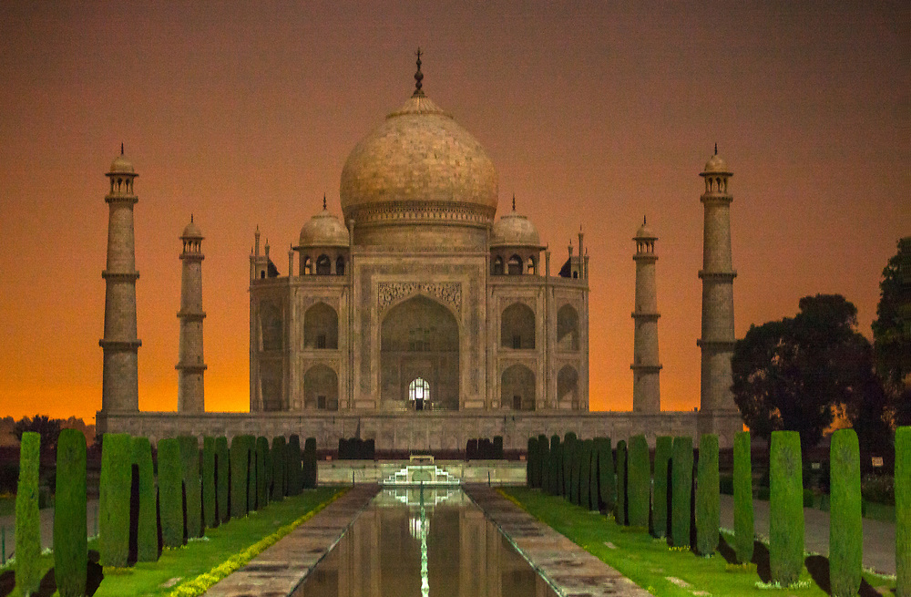 Taj Mahal at moonlight. It is an ivory-white marble mausoleum on the southern bank of the river Yamuna in the Indian city of Agra