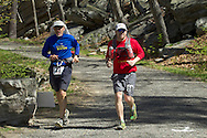 Gardiner, New York - Trishul Lorne W. Cherns (17) Tom Reynolds (68) compete in the Rock the Ridge 50-mile endurance challenge race at the Mohonk Preserve on May 4, 2013. The race is part of Mohonk's 50th anniversary celebration and a fundraiser for the preserve.