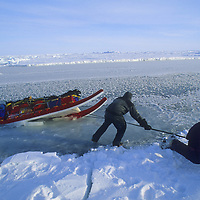 Team struggles to keep sled from sinking into Arctic Ocean after thin ice broke.