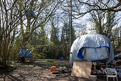 Denham, UK. 6th April, 2021. Dwellings at Denham Ford Protection Camp which is occupied by environmental activists from HS2 Rebellion who are opposed to the HS2 high-speed rail link. Thousands of trees have already been felled in the Colne Valley where HS2 works will include the construction of a Colne Valley Viaduct across lakes and waterways and electricity pylon relocation.