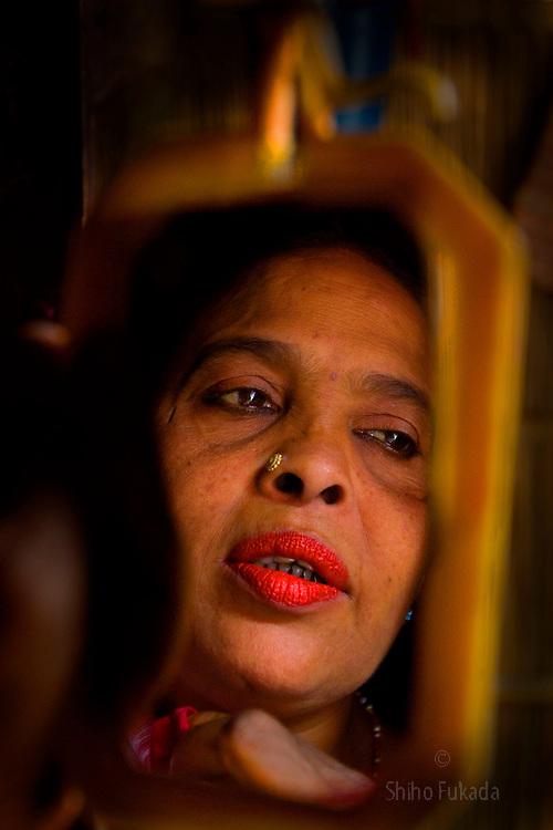 Aging sex worker Josna, 60, is seen at brothel in Faridpur, Bangladesh.