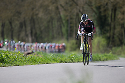 A lone rider from BTC City Ljubljana Team is stuck between the breakaway and the peloton durint the first lap of the Flèche Wallonne Femmes - a 137km road race from starting and finishing in Huy on April 20, 2016 in Liege, Belgium.
