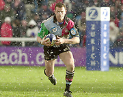 Twickenham. Surrey, UK., 23 February 2002, Zurich Premiership Rugby,  The Stoop Memorial Ground,   Quin's Nick Burrows, starts a driving run, through the snow at the stoop, during the, NEC Harlequins vs Gloucester Rugby,<br /> [Mandatory Credit: Peter Spurrier/Intersport Images],
