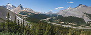 See Mount Athabasca (left, 3491 meters or 11,453 feet), Icefields Parkway, and Sunwapta Pass from Parker Ridge viewpoint, Banff National Park, Alberta, Canada. Banff is part of Canadian Rocky Mountain Parks World Heritage Site declared by UNESCO in 1984. Panorama stitched from 2 images.