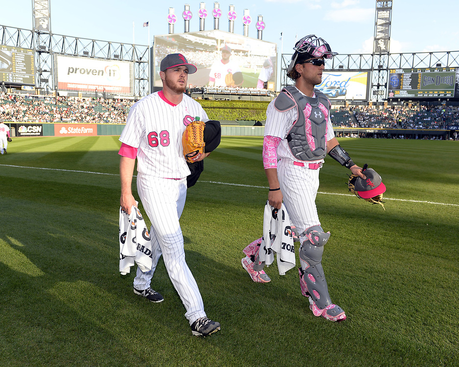 CHICAGO - MAY 12:  Starting pitcher Dylan Covey #68 walks in from the bullpen with Kevan Smith #36 of the Chicago White Sox prior to the game against the San Diego Padres on May 12, 2017 at Guaranteed Rate Field in Chicago, Illinois.  (Photo by Ron Vesely)  Subject: Dylan Covey; Kevan Smith