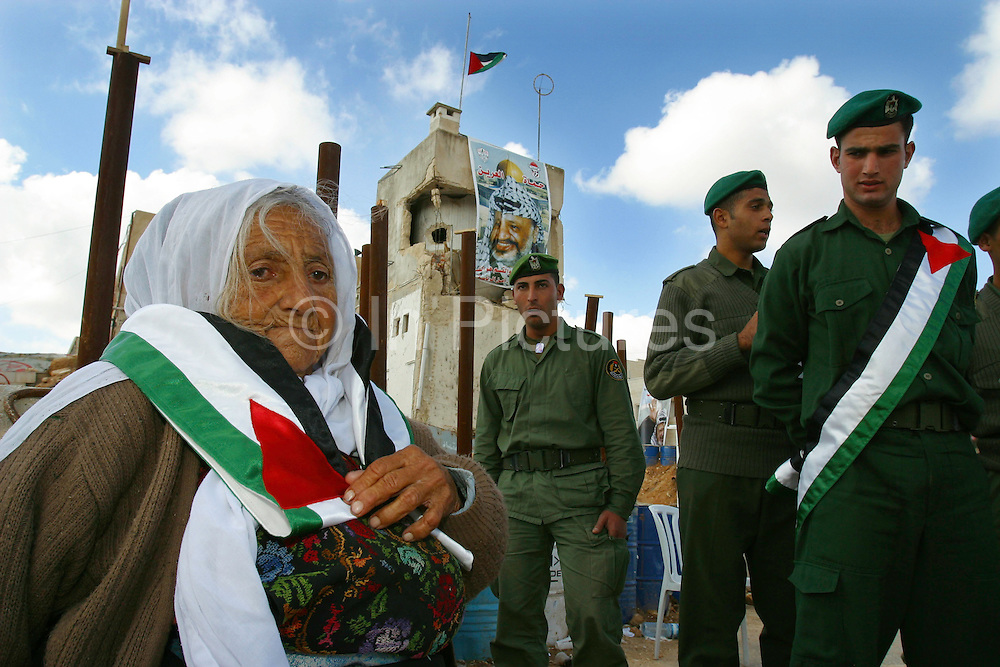 At the Palestinian headquarters in Ramallah, West Bank, Yasser Arafat's death is mourned by soldiers & visitors at his tomb. Um Abed a local elderly lady and friend of Arafat visited him regularly when he was ill for coffee. She insists his death was suspicious.