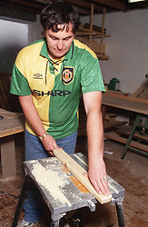 Man with learning difficulties doing woodwork in workshop,