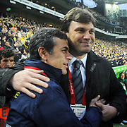 Fenerbahce's coach Aykut KOCAMAN and Bursaspor's coach Ertugrul SAGLAM (R) during their Turkish superleague soccer match Fenerbahce between Bursaspor at the Sukru Saracaoglu stadium in Istanbul Turkey on Sunday 03 April 2011. Photo by TURKPIX