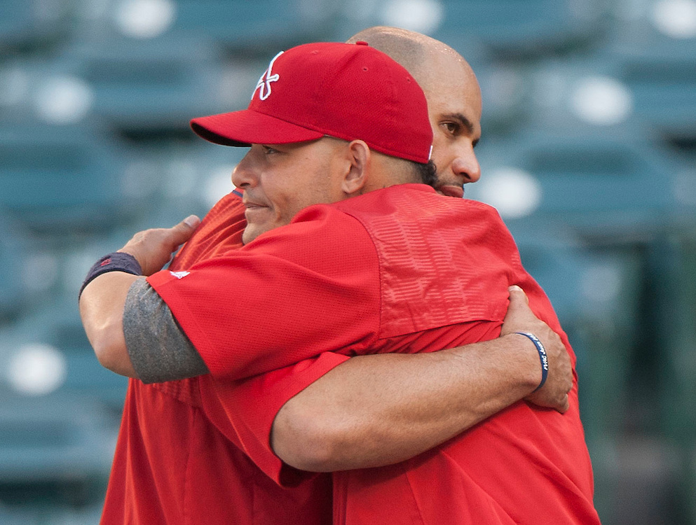 The Angels' Albert Pujols and Cardinals' Yadier Molina hug during batting practice before the Angels' 5-2 loss to the St. Louis Cardinals Wednesday night at Angel Stadium.<br /> <br /> ///ADDITIONAL INFO:   <br /> <br /> angels.0512.kjs  ---  Photo by KEVIN SULLIVAN / Orange County Register  --  5/11/16<br /> <br /> The Los Angeles Angels take on the St. Louis Cardinals at Angel Stadium Wednesday.<br /> <br />  5/11/16
