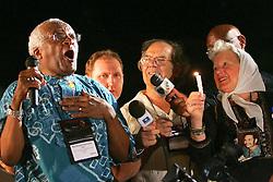 O ex-arcebispo da Igreja anglicana da Africa do Sul e Premio Nobel da Paz, Desmond Tutu (E) discursa ao lado do Premio Nobel da Paz 1980, argentino Adolfo Perez Esquivel (C) e de Maria Cortinez(D), uma das maes da Praca de maio diante de um publico de quatro mil pessoas que participou da marcha pela paz nas ruas de Porto Alegre commo atividade na 9ª Assembleia do Conselho Mundial de Igrejas (CMI) que acontece de 14 a 23 de fevereiro.  FOTO: Jefferson Bernardes/Preview.com