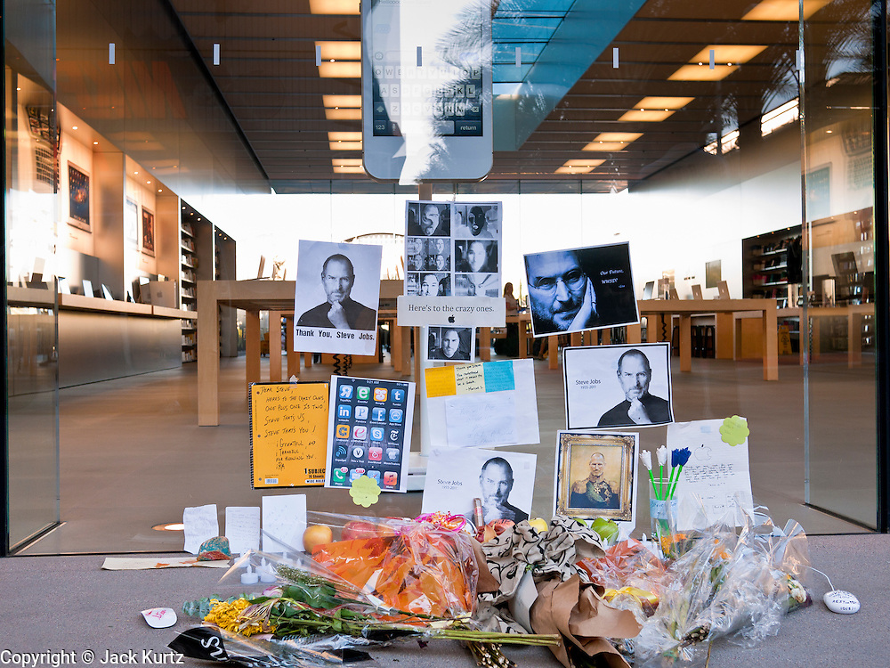 14 OCTOBER 2011 - SCOTTSDALE, AZ:  A shrine for the late Steve Jobs, who passed away last week from complications from pancreatic cancer, the Apple Store in Scottsdale Quarter just before the iPhone 4S went on sale. Hundreds of people lined up at the Apple Store in the Scottsdale Quarter in Scottsdale, AZ, Friday, Oct. 14, to buy the iPhone 4S. The phone sold out in pre-orders last week and sales at the Scottsdale Apple Store were brisk through the morning.      PHOTO BY JACK KURTZ