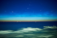 Noctilucent Clouds Over the Baltic Sea. From my cabin on the MV Explorer while traveling from Stockholm to Copenhagen. Composite of 33 images taken with a Nikon D4 camera and 28 mm f/1.8 lens (ISO 800, 28 mm, f/1.8, 1 sec). Raw image processed with Capture One Pro, and Photoshop CC (statistics, maximum).