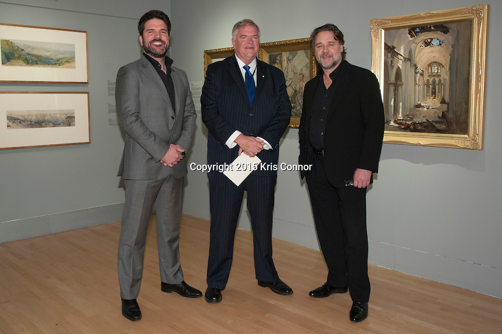 """Producer Keith Rodger, Russell Crowe and The Hon Kim Beazley, Ambassador of Australia, during a viewing of the """"A Centenary of Australian War Art"""" exhibit at the Embassy of Australia in Washington DC on April 7th, 2015. Crowe and Rodgers are visiting the nation's capitol to promote the new Warner Bros. Pictures' movie """"The Water Diviner,"""" which will be release on April 24th. Photo by Kris Connor for Warner Bros. Pictures"""