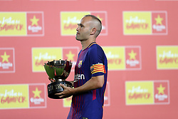August 7, 2017 - Barcelona, Spain - Andres Iniesta of FC Barcelona holds the Joan Gampar Trophy during the 2017 Joan Gamper Trophy football match between FC Barcelona and Chapecoense on August 7, 2017 at Camp Nou stadium in Barcelona, Spain. (Credit Image: © Manuel Blondeau via ZUMA Wire)